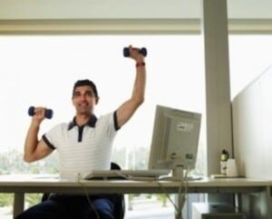 carrying dumb bell at office desk