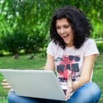 Girl Using Laptop in park