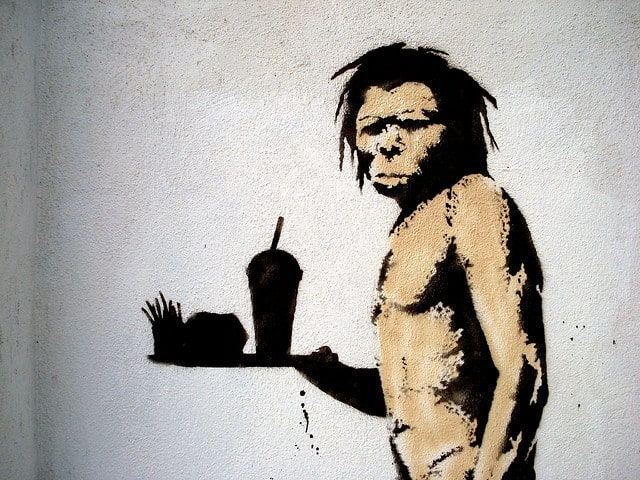 Caveman holding food tray