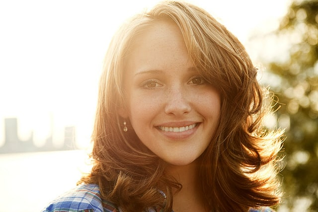 Backlit portrait of woman smiling