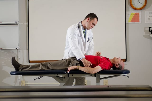 liver disease - surgeon looking at patient