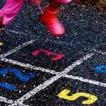 raise happy kids - girl playing hopscotch